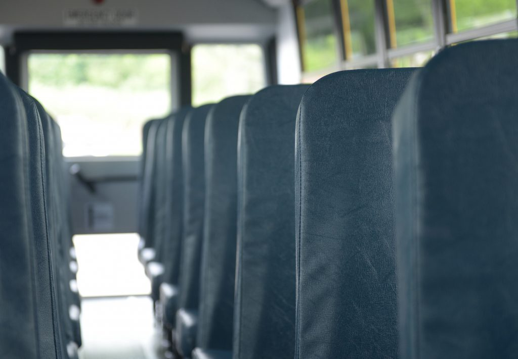 A lineup of school bus seats, most school buses don't have seat belts
