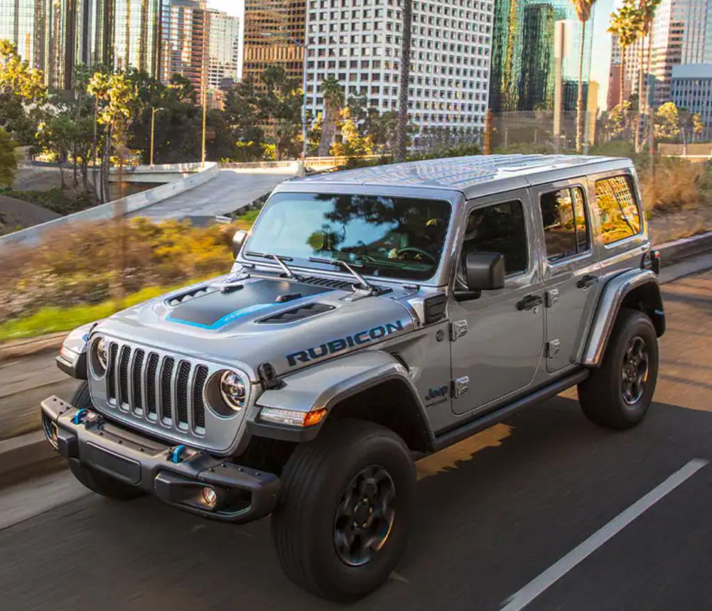 A 2021 Jeep Wrangler Rubicon 4xe driving through the city