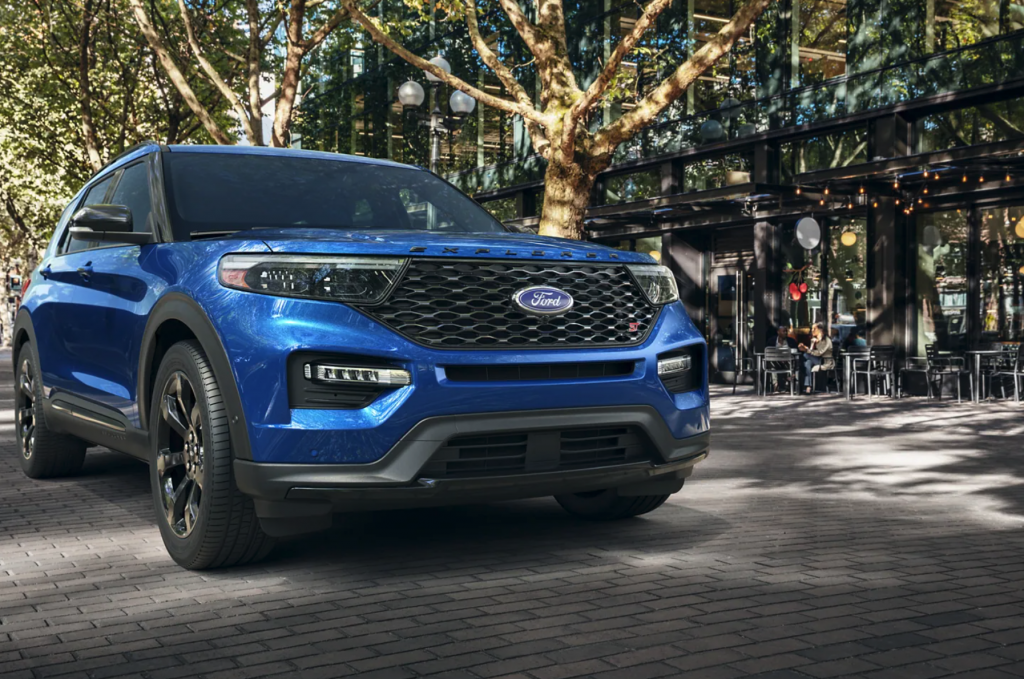 A blue 2021 Ford Explorer ST parked in the city