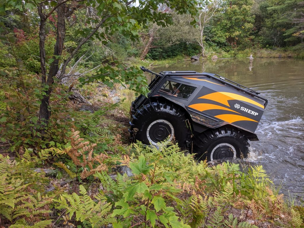 The Sherp ATV amphibious vehicle model exiting water