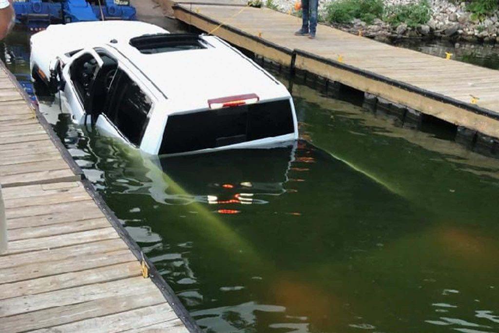 retrieving a sunk GMC Sierra