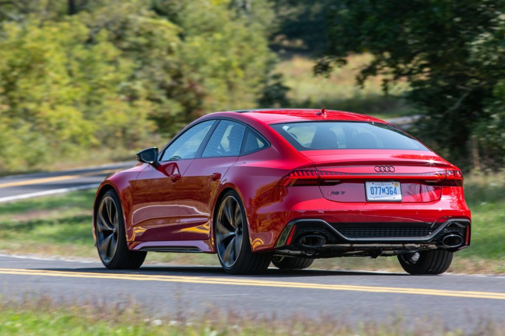 Press photo of a red 2021 Audi RS7 cornering, one of Car and Driver's most beautiful sedans of 2021
