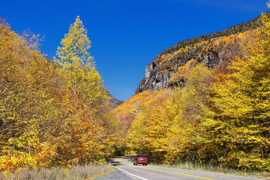 Scenic autumn drive through Smugglers Notch, one of the best scenic drives for leaf-peeping in the northeast