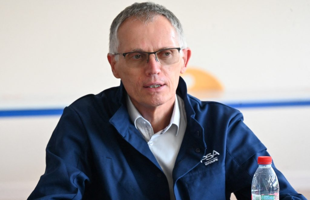 Stellantis CEO Carlos Tavares answers journalists' questions after a private visit at the plant of Dutch multinational automotive manufacturing company Stellantis on July 2, 2021
