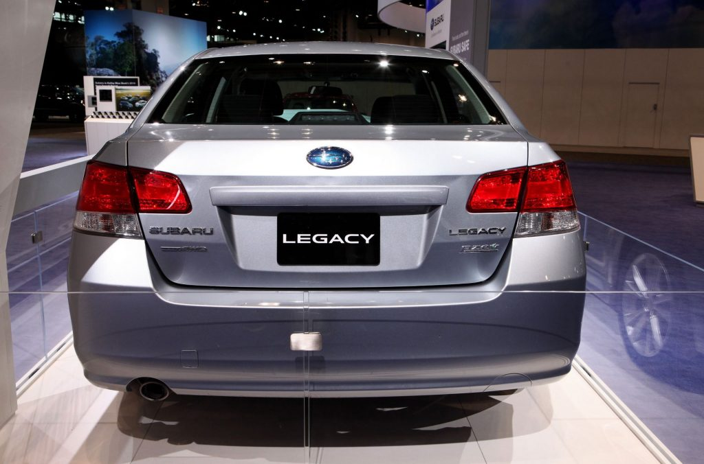 A damaged Subaru Legacy sedan model featured at the 109th Annual Chicago Auto Show