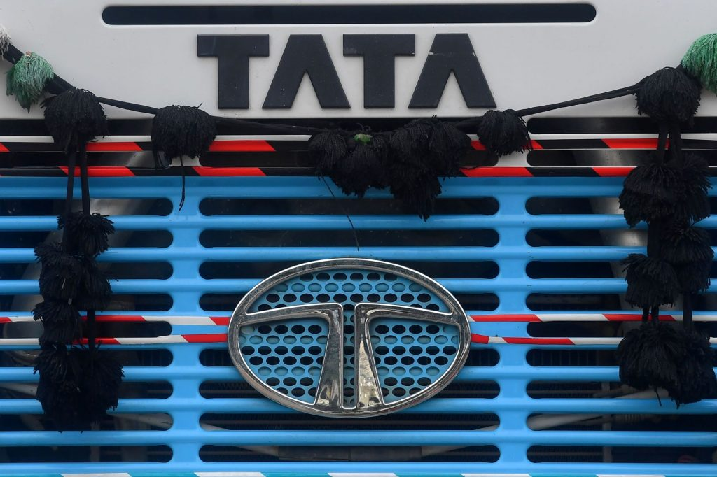 The Tata Motors logo and signage on an engine grille in Mumbai, India