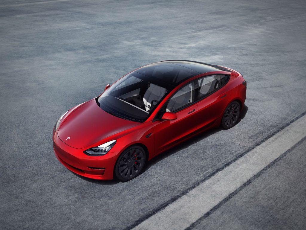 A red 2019 Tesla Model 3