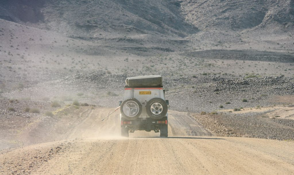 A Toyota Land Cruiser driving in the desert in Fish River Canyon