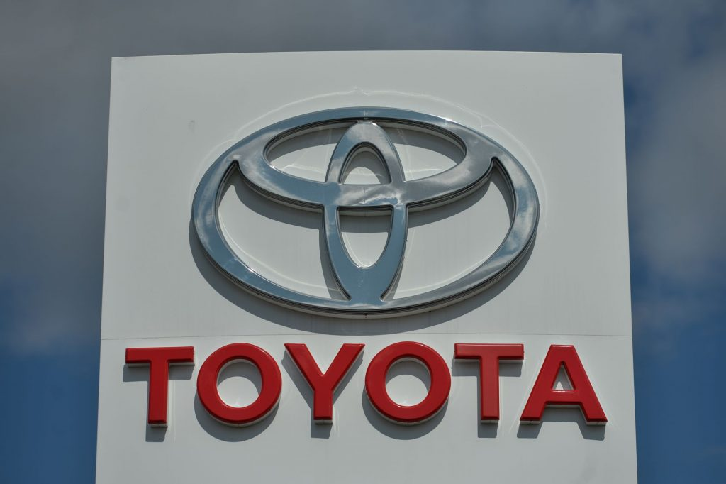 Toyota dealership sign with the logo and company name written underneath.