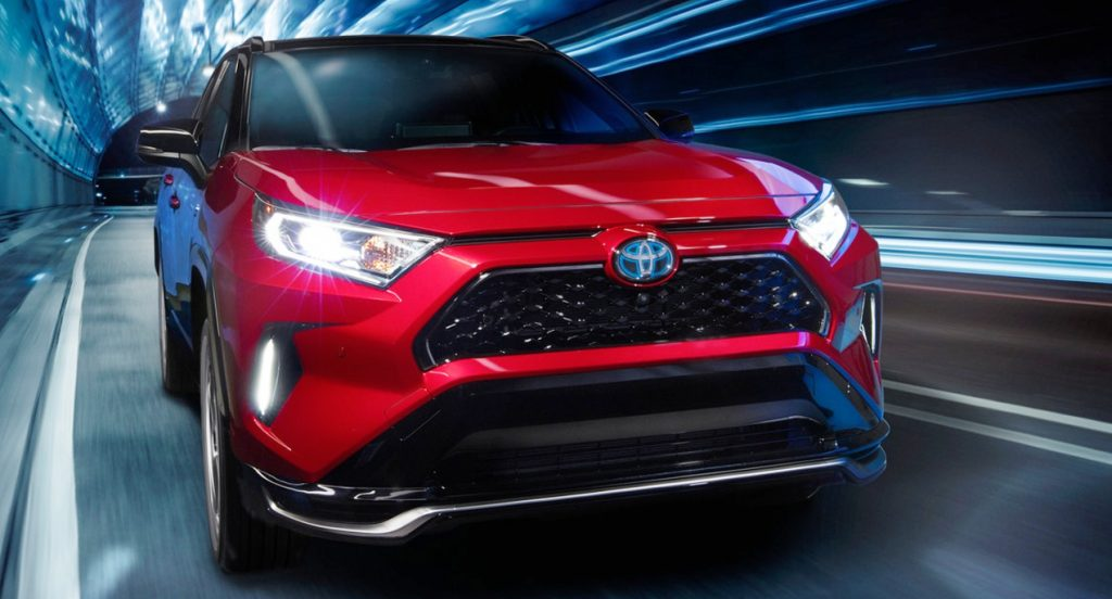 a red 2021 Toyota RAV4 Prime is one of the best Toyota crossover SUV models shown here in red driving at speed in a tunnel
