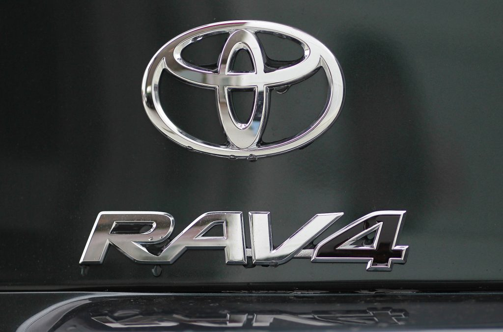 The Toyota and RAV4 logos displayed on the back of a Toyota RAV4 at a dealership in Oakland, California, in 2011