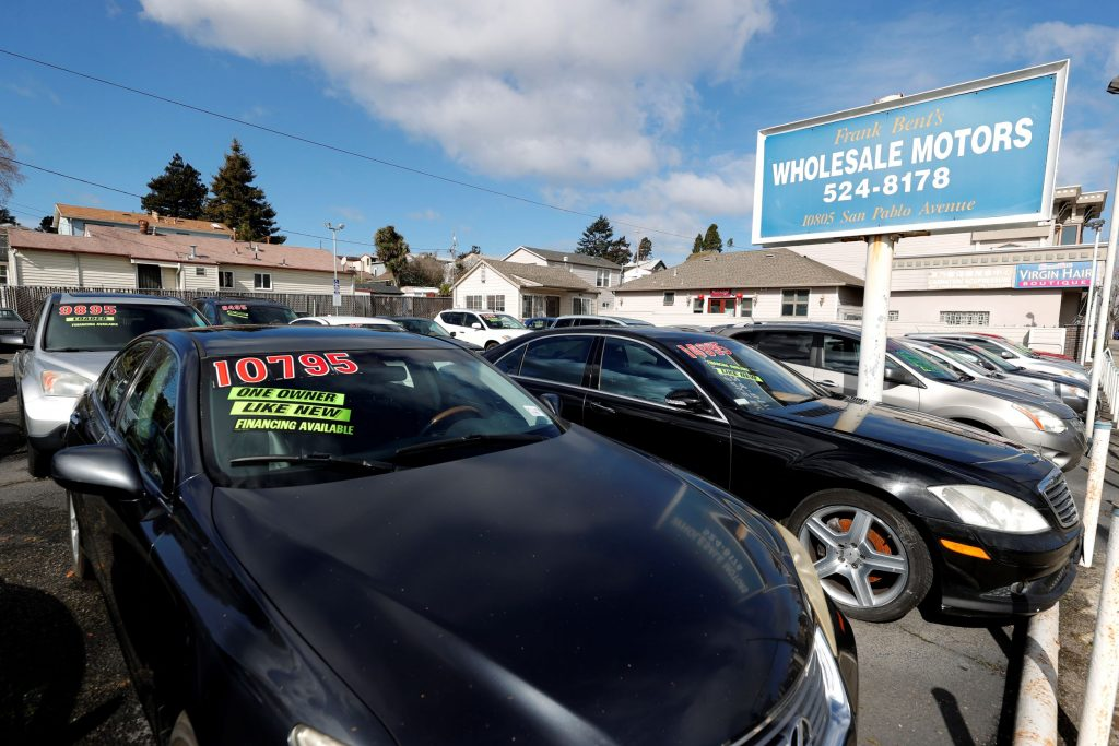 Used cars with prices on their windshields in a California lot
