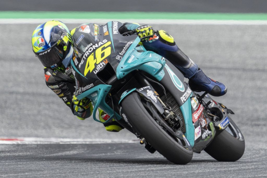 Valentino Rossi on his motorcycle leaning into a curve on the track.