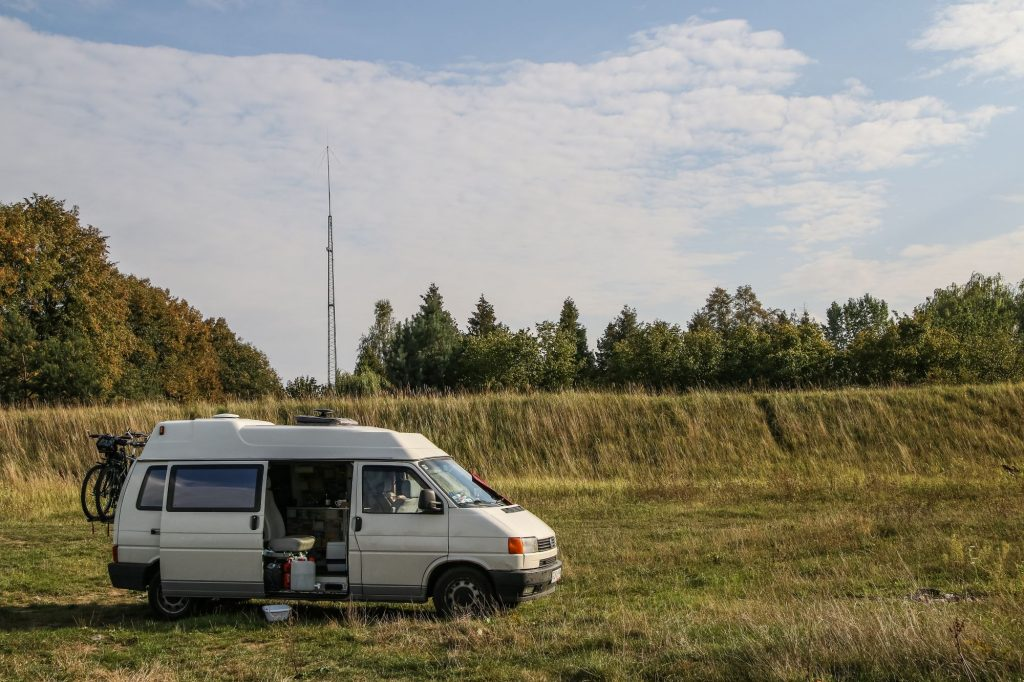 A Volkswagen Transporter T4 van boondocking on the Bug river bank near Malkinia, Poland