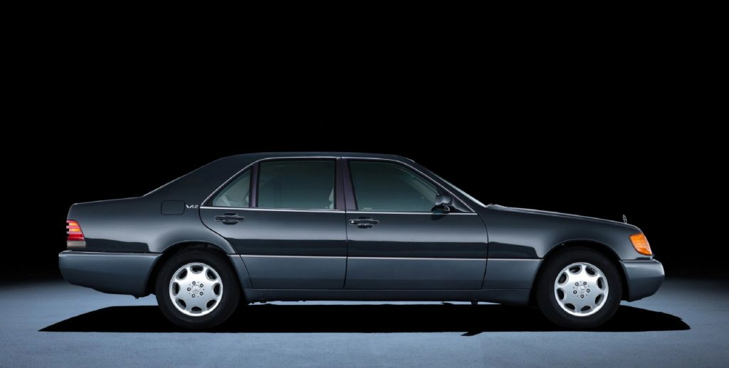 The side view of a black W140 Mercedes-Benz 600SEL S-Class