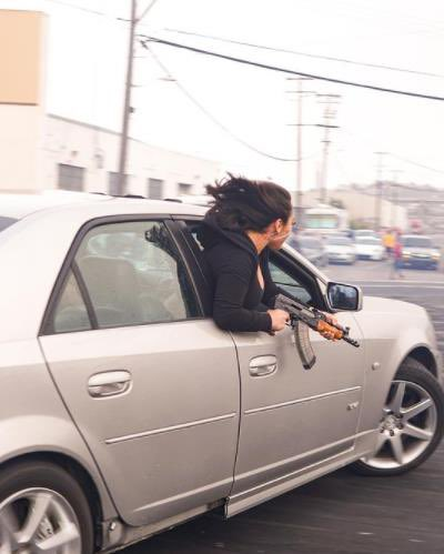 Woman in CTS-V with AK-47 assault rifle