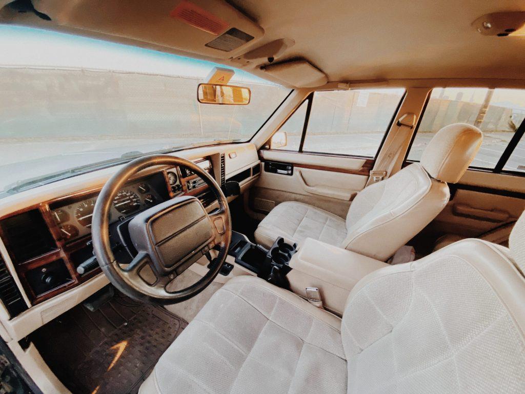 Overland Jeep Cherokee XJ interior with tan seats
