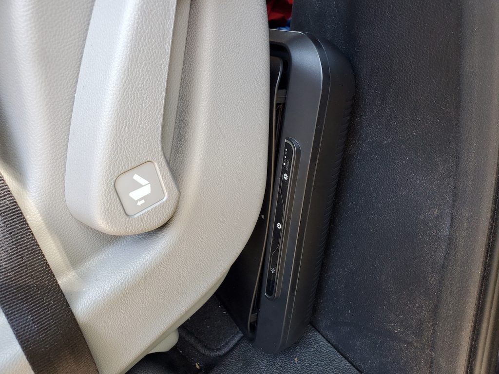 Close-up of Medify Air MA-CAR HEPA air purifier behind seat in a vehicle