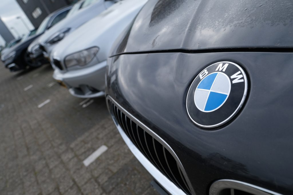 bmws parked outside dealership