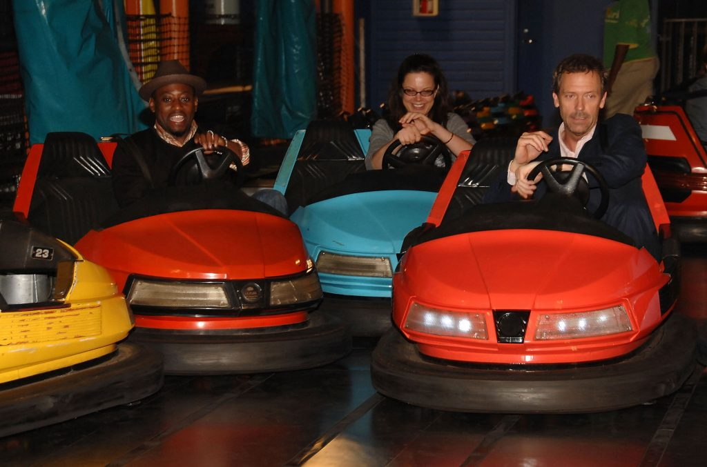 Actors Omar Epps and Hugh Laurie ride bumper cars in Pacific Park on the Santa Monica Pier in California in July 2007