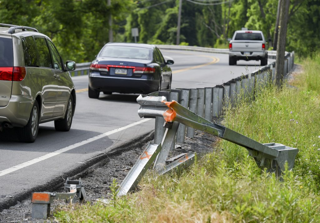 A broken guardrail on Route 10 at the intersection with Hope Way Lane in Cumru Township, Pennsylvania, in June 2021. Carfax reports can show if used vehicles have been in accidents such as this one.
