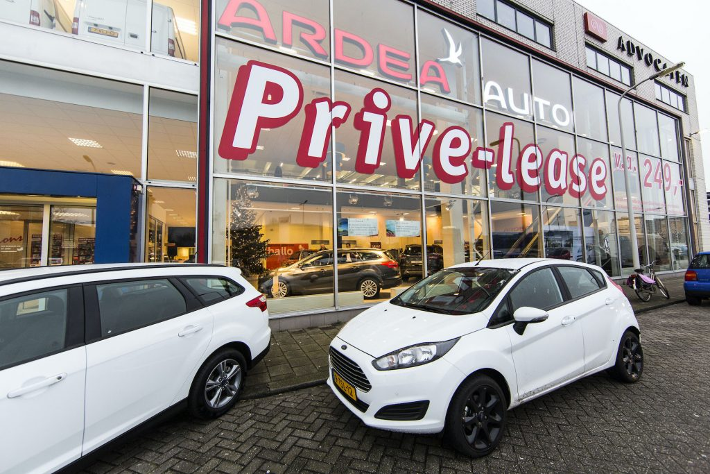 A Ford car showroom promotes the sale of private leases.