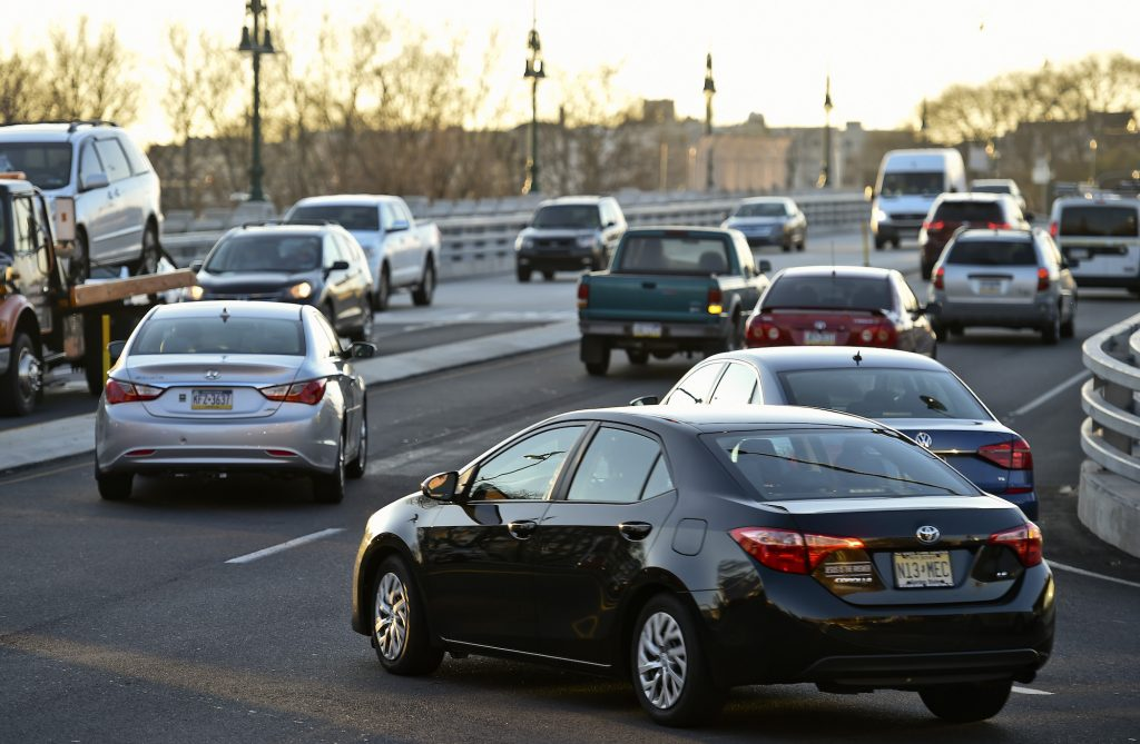 Cars on the Penn Street Bridge at rush hour in Reading, Pennsylvania, in December 2020. City driving can wreak havoc on a vehicle's brakes.