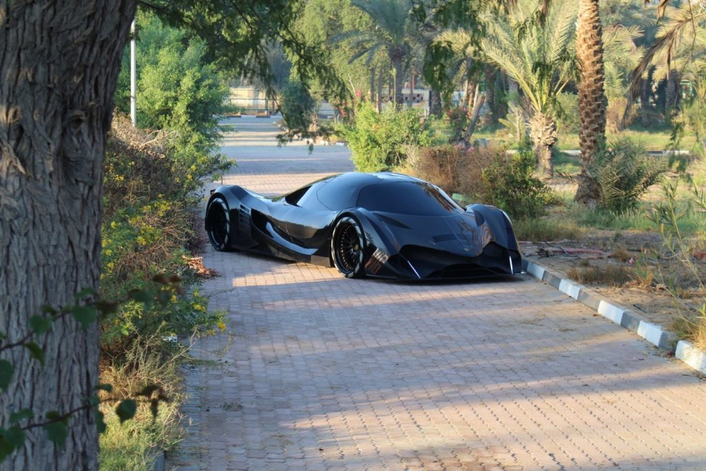 a Devel sixteen parked on a walk way in a garden and wil have the most horsepower of any car