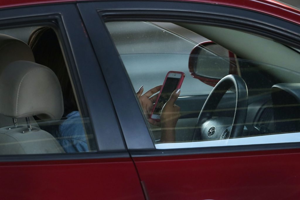 A driver distracted by her phone