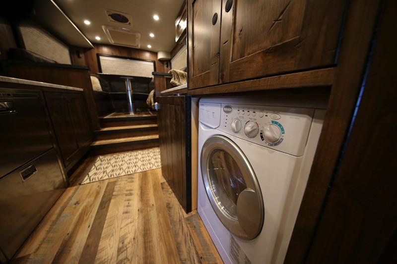 EarthRoamer HD camper truck inside shot showing washer/dryer
