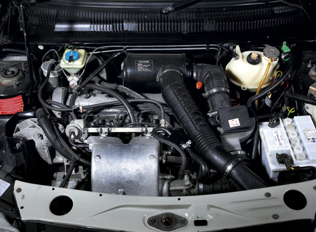 Engine bay of a 1987 Peugeot 205 GTI 1.6