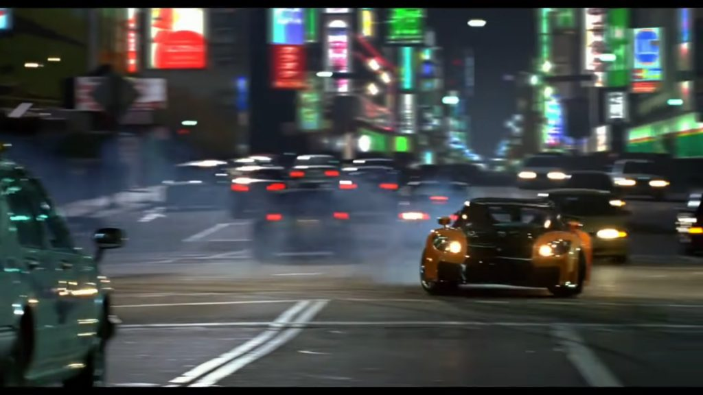 """A scene The Fast and the Furious: Tokyo Drift featuring the character """"Han"""" drifting in downtown Tokyo."""