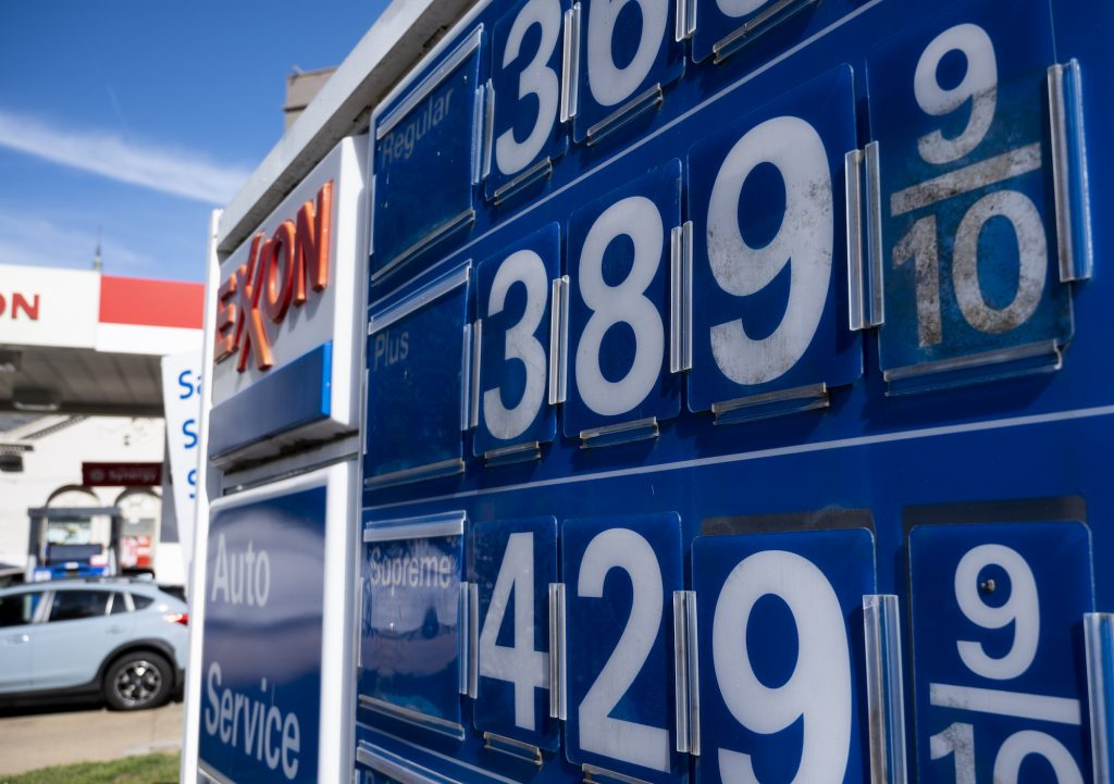 Gas prices displayed at an Exxon gas station on Capitol HIll in Washington on Monday, March 15, 2021