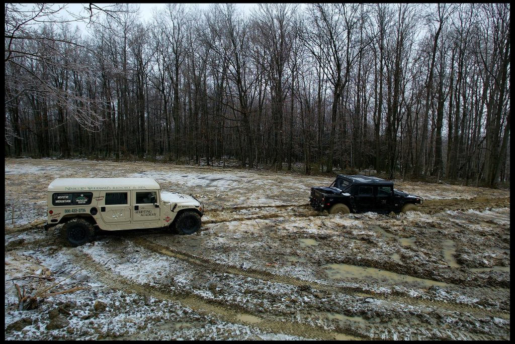 A beige H1 hummer winches a black H1, it is capable of winning a tug-of-war battle