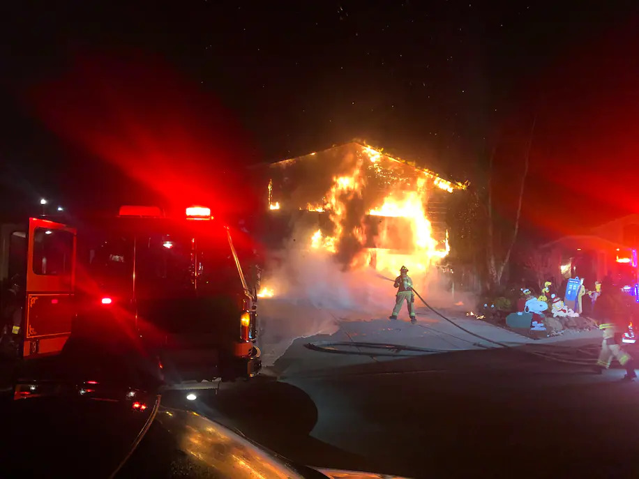The Vindum family's home engulfed in flames