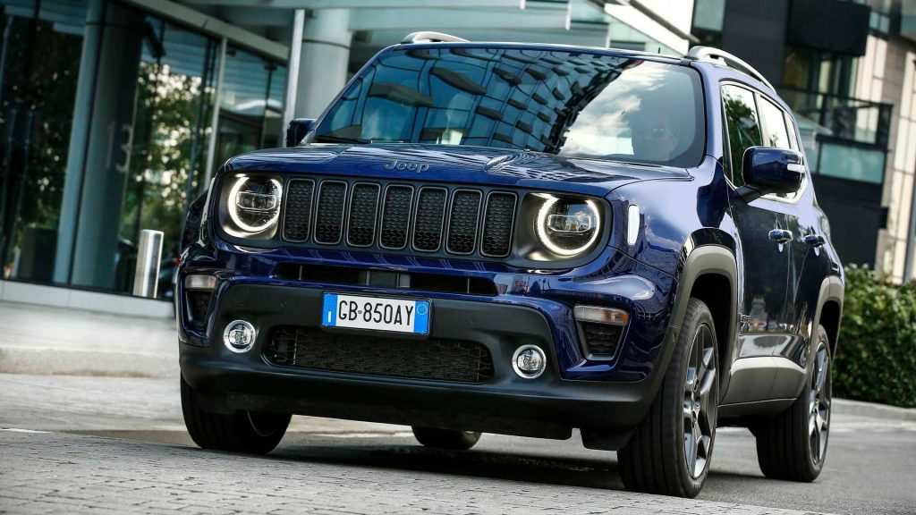 The 2021 Jeep Renegade 4xe driving down the street