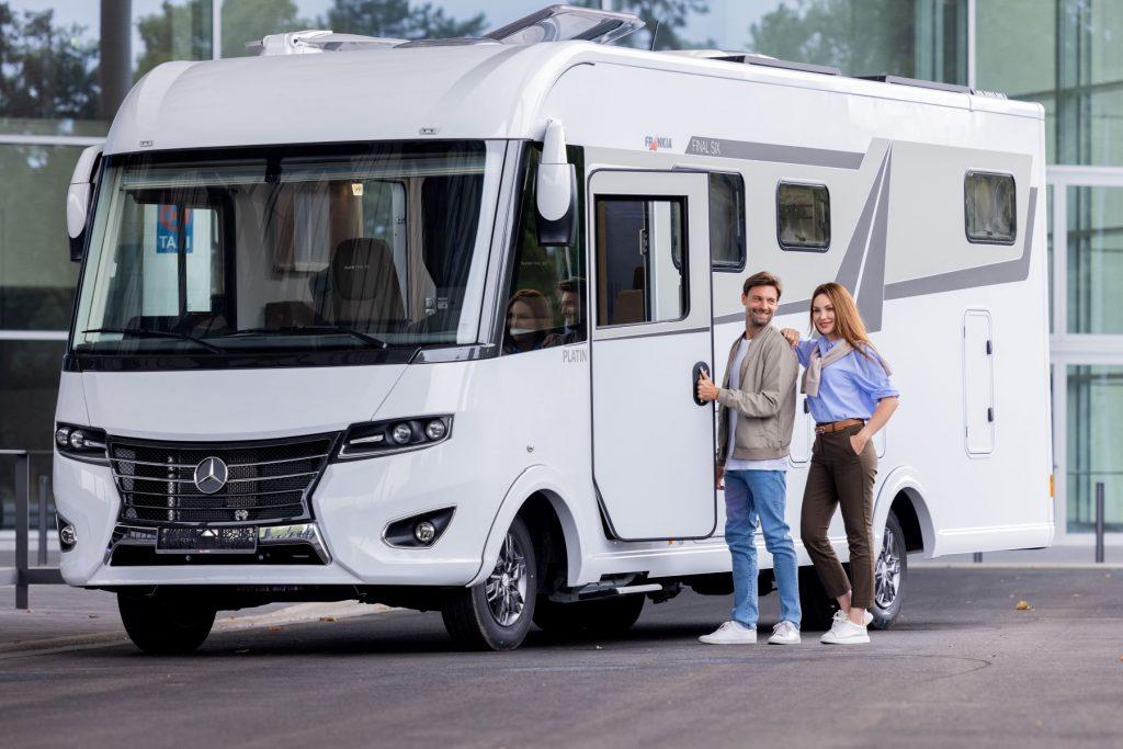 A couple entering a Mercedes-Benz RV during the Caravan Salon motorhome and caravan trade fair