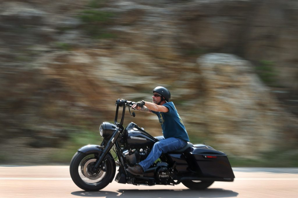 A man rides a motorcycle on the road to Mt. Rushmore on August 9, 2021, near Keystone, South Dakota. Motorcycle equipment rules dictate handlebar position, among other things.