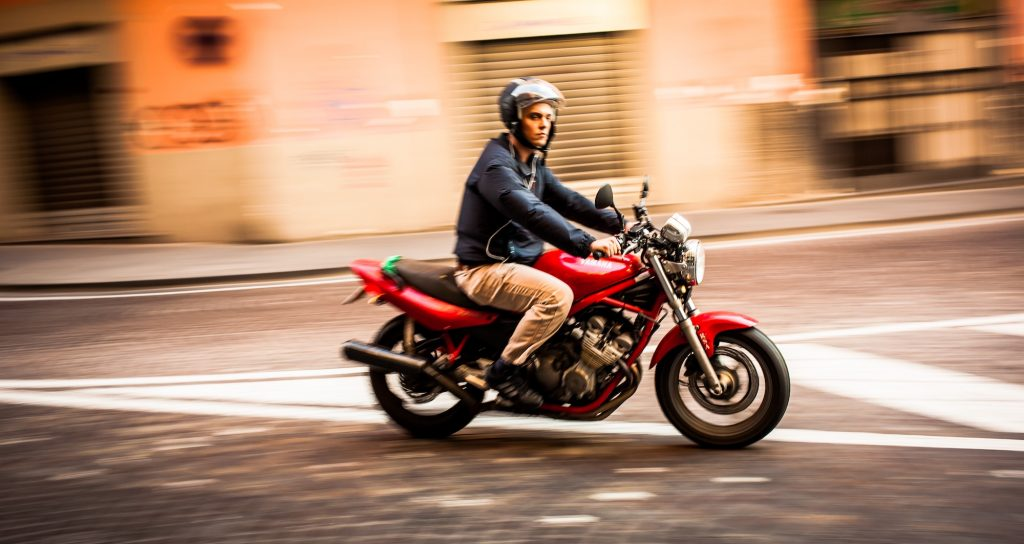 A man rides a motorcycle through the streets of Naples, Italy, in October 2012. One Italian man's motorcycle accident caused his heart to rotate 90 degrees.