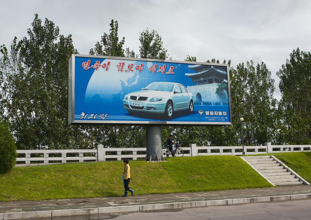 Pyeonghwa motors car advertising billboard, Pyongan Province, Pyongyang, North Korea.