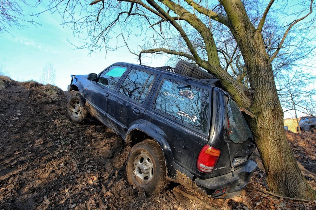 A 4x4 Ford Explorer SUV crashed into a tree while mudding