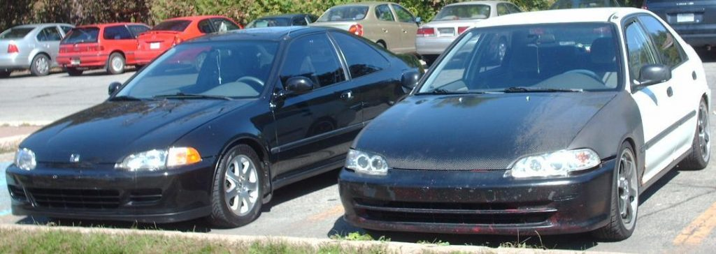 Two 1995 Honda Civics parked next to each other