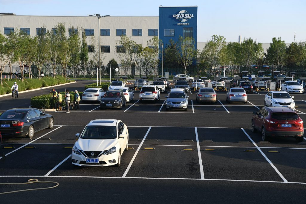 Cars sit parked at a parking lot outside Universal Beijing Resort on August 24, 2021 in Beijing, China.