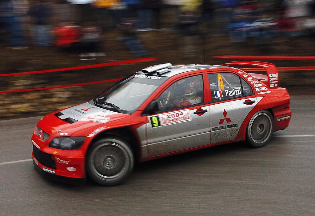 French Gilles Panizzi and his co-pilot Herve Panizzi take a turn in their Mitsubishi Lancer WRC04 during their practice session, before the 72nd Monte Carlo Rally.