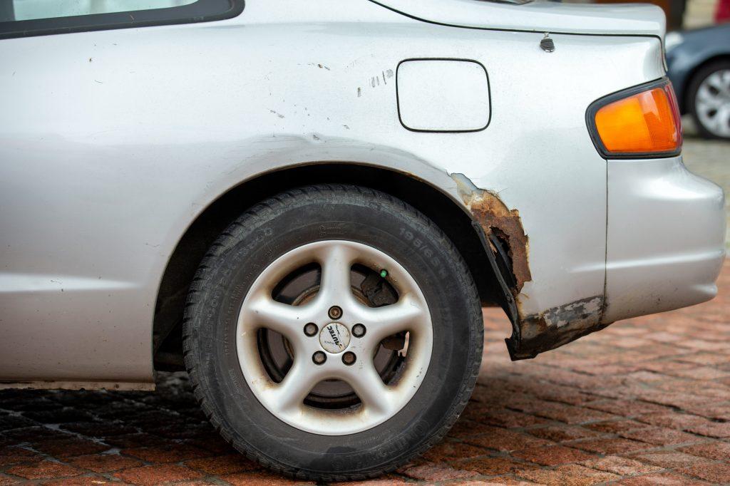 A rusty used car