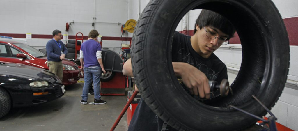 Student Joseph Ziemek patched a leaking tire during an auto tech class.