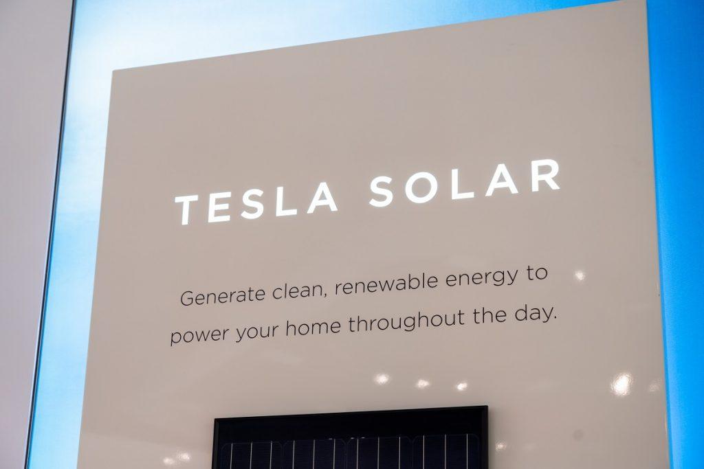 A sign for Tesla solar.