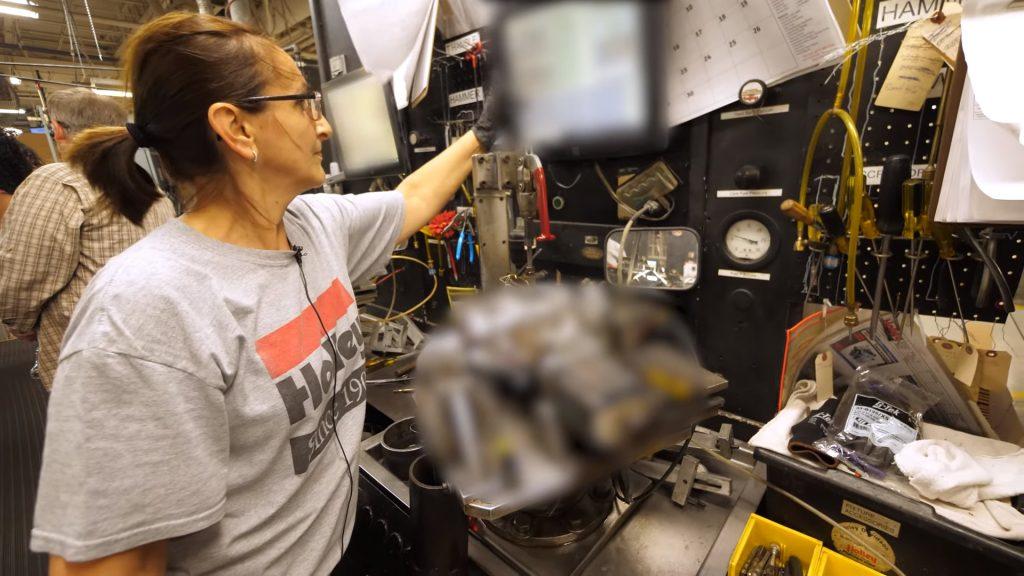 An Holley Performance employee using their secret proprietary carburetor testing machine.