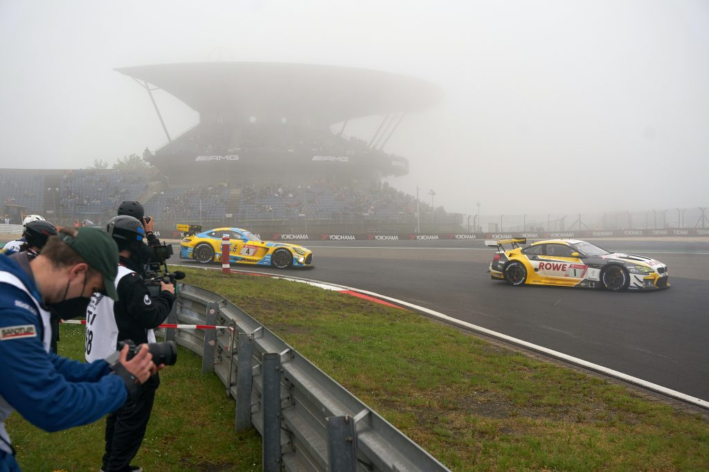 Two cars race at the Nürburgring