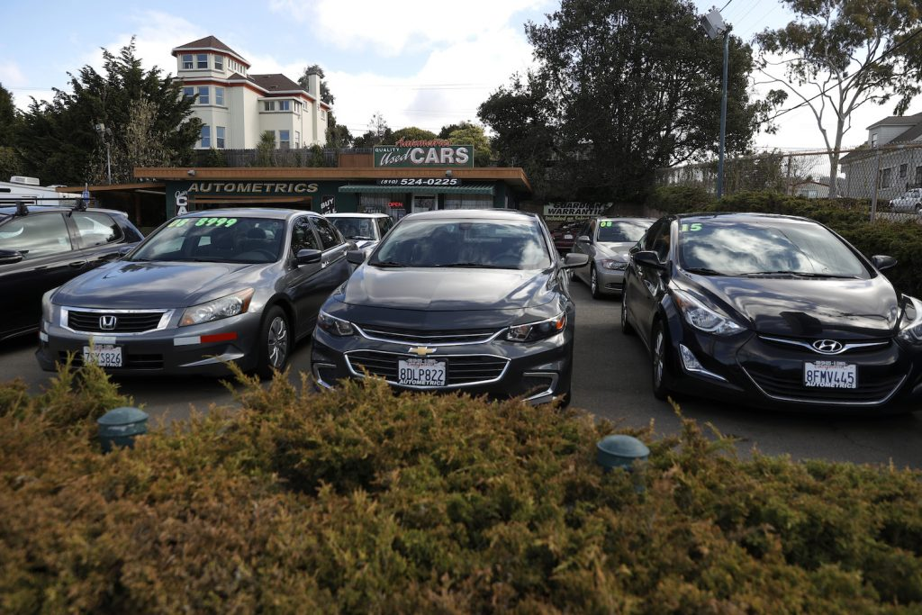 Used cars sit on the sales lot at Autometrics Quality Used Cars on March 15, 2021 in El Cerrito, California